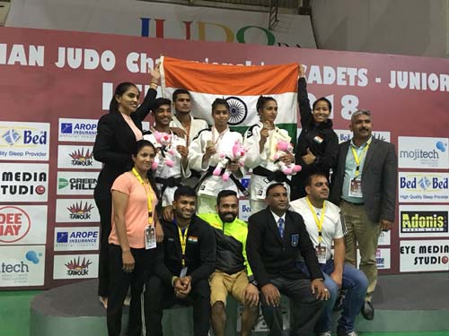 Junior Medalists with Coaches